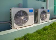 Air conditioning units outside an apartment complex Royalty Free Stock Photos