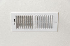 Air Conditioning Vent in Textured Wall Background With Copy Space Royalty Free Stock Photos
