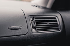 Air conductor in the car . conditioner grille . Air conductor car . conditioner grille close up Royalty Free Stock Photos