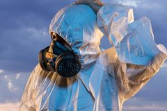 air contaminated by pollution, man with mask and protective suit royalty free stock photos