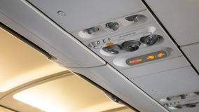 Air control knobs,light for Belt warning signals and Non-smoking on the plane royalty free stock photos