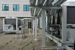 Air cooled water chiller plant with pipework Royalty Free Stock Photos