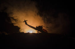Air Crash. Burning falling helicopter. Destroyed helicopter. Decorated with toy at dark fire background. War or terrorism Stock Photography