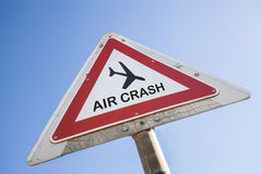 Air crash. Red and white warning triangle with the symbol of an airplane and the words air crash Royalty Free Stock Photography