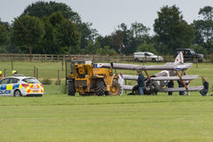 Air crash at Shuttleworth Airshow. Biggleswade, UK - 29 June 2014: A vintage 1916 British Sopwith Triplane crash landed at the Shuttleworth Collection air show Royalty Free Stock Image