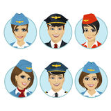 Air crew member avatars of pilots and stewardesses. Over white background Royalty Free Stock Images