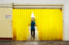 Air Curtains and The Man Walk Thru. The Worker Walk thru the Air Curtains Royalty Free Stock Photography