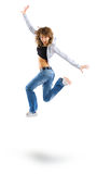 Air dance. Dancing woman with brown long hair and happy smiling facial expression jumping up. Studio isolated on white background Stock Image