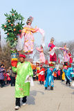 Air dancing. The girls dressed up as drama personae and performed in the air during the 2015 Spring Festival Temple Fair in Taiyuan, Shanxi, China Stock Photo