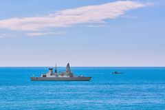 Air-defence Destroyer in the Sea. Air-defence Destroyer and Submarine in the Sea Stock Photo