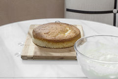 Air delicious biscuit cake with a bowl of cream Stock Image
