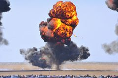 Seaside explosions. After an air display, this explosion was to simulate a bombing run by Tornado aircraft Stock Photos