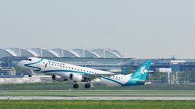 Air Dolomiti Embraer taking off from Munich Airport. Air Dolomiti Embraer takes off from Munich Airport, MUC stock video