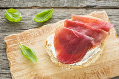 Air dried Breasola ham on a roll Royalty Free Stock Photography