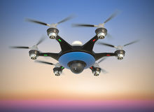 Air drone with surveillance camera flying in sunset sky. Stock Images