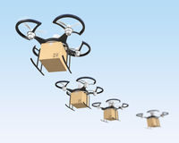Air drones with carton package in the sky Royalty Free Stock Photos
