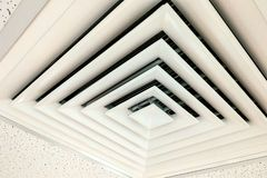 Air Duct Ceiling white, Air duct in square shape, condition vent modern air conditioner or air vent on ceiling white, Duct for. Air duct in square shape stock photo