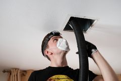 Air duct cleaning, drill, ductwork, man, hvac. Air duct cleaning with drill, cleaning the registers, white man stock image