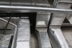 Installed rectangle air duct system. Air duct system with installed rectangle and circle air duct Royalty Free Stock Photo