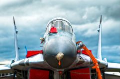 Air fighter. Front view of the air fighter on the ground with blue sky in background Royalty Free Stock Photos