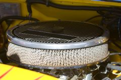 Air Filter. Retro style air filter under hood stock image