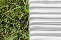 Air filter and grass Royalty Free Stock Image