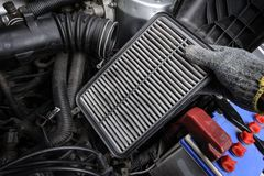 Air filter. Technician changing the air filter for car stock photos