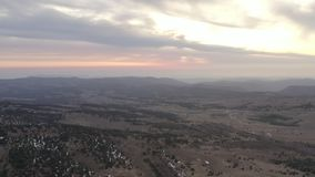 Air flight over beautiful green mountain valley. Amazing red sunset with clouds. Air flight over beautiful green mountain valley. Panoramic view from amazing red stock video