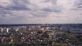 Air flight over a swamp with dry withered grass with a lake of dark blue water with reflections of clouds near the city. Aerial video, drones, cloudy day stock video