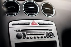The air flow inside the car. Detail audio system buttons in car. Interior of luxurious sport car. modern car interior. air condition in auto. car multimedia and Royalty Free Stock Photography