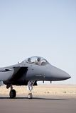 Air force - F15. Strike eagle on tarmac against blue sky Stock Image