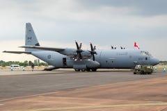 Air Force Lockheed C-130 Hercules transport plane on the tarmac. Royal Canadian Air Force Lockheed C-130J-30 Hercules transport plane on the tarmac of RAF stock photo