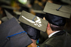 Air Force Member at University Graduation. Students at a graduation ceremony. Men and women sitting in caps and gowns listening to the commencement speaker. An Stock Images
