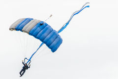 Air force sky diver parachute. Air force skydiver parachuting at the colorado springs hot air balloon festival - blue parachute - military soldier Stock Photos