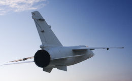 Air forces. A fighter flying, seen from behind Stock Image