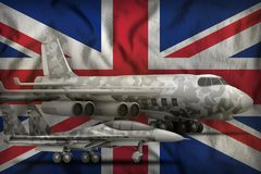 United Kingdom UK air forces concept on the state flag background. 3d Illustration. Air forces with grey camouflage on the United Kingdom UK flag background Stock Photo