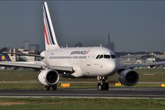 Air France. An Air France Airbus A319 lines up on the runway, preparing for take off at Frankfurt International Airport, with the city skyline on the background Royalty Free Stock Photography