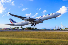 Air France Airbus A340. Taking off from St. Maarten airport in the Caribbean Royalty Free Stock Photography