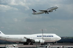 Air France airplanes. Air France's  airplanes are taking off and on the run-way. Airport of Charles-de-Gaul. Paris. France Stock Images
