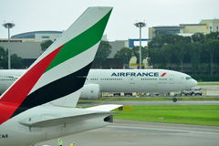 Air France Boeing 777-300ER taxiing past an Emirates Boeing 777-300ER Royalty Free Stock Image