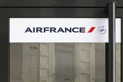 Air France logo on a door of a store. Lyon, France - February 26, 2017: Air France logo on a door of a store. Air France is the French flag carrier headquartered stock image