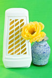 Air freshener. A closeup of a WC air freshener and a yellow rose in a vase stock image