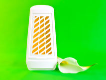 Air freshener. A closeup of a WC air freshener and a white lily stock images