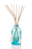 Air freshener bottle with scented sticks. Blue air freshener bottle with scented sticks, isolated on white Stock Photos
