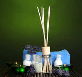 Air freshener, bottles, towel and candles Royalty Free Stock Photos