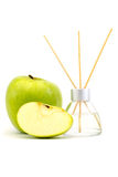 Air freshener sticks with a green apple isolated. Air freshener sticks with a green apple on a white background Royalty Free Stock Images