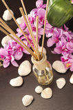 Air freshener sticks at home with flowers and ou of focus backgr. Air freshener sticks at home with flowers Stock Photo
