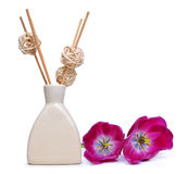 Air freshener with wooden aroma sticks and tulip flowers. On white background Stock Photos