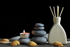 Air freshener with wooden aroma sticks and zen pebbles. Stock Photography