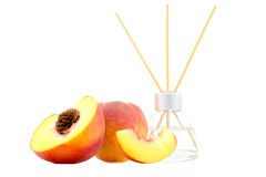 Air fresheners with peach in a glass jar with sticks isolated on a white. Background Stock Images